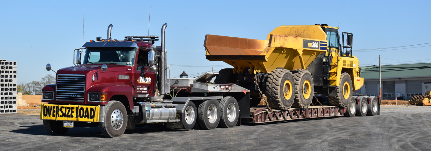 A dump truck being hauled[::]H.L. Wiker Awards and Recognitions