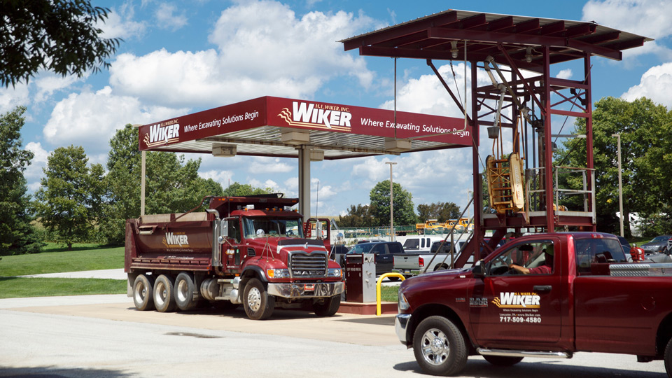 Shot of various Wiker trucks prepping to go out to a jobsite