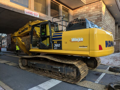 Excavator going under clearance of a buildling[::]Fulton Bank Headquarters Commercial Project in Lancaster, PA