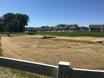 Open space in a residential area that has been excavated and ready for construction[::]Frederick Living Basin Conversion Residential Project in Zieglerville, PA