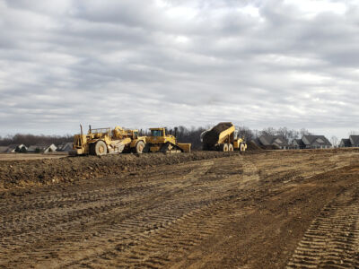 Multiple pieces of excavating equipment clearing land in a residential neighborhood[::]Honeycroft Village Residential Project in Cochranville, PA